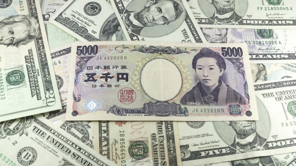 five-thousand-japanese-yen-notes-on-many-dollars-background-30615054_16x9
